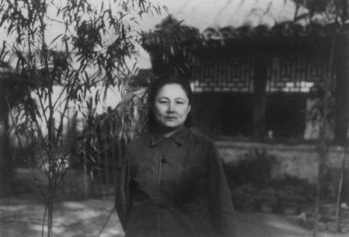 Lao Lao in front of her house